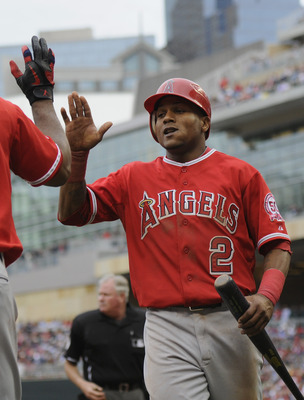 MINNEAPOLIS, MN - MAY 29: Erick Aybar #2 of the Los Angeles Angels of Anaheim celebrates scoring against the Minnesota Twins during the eighth inning of their game on May 29, 2011 at Target Field in Minneapolis, Minnesota. Angels defeated the Twins 6-5. (