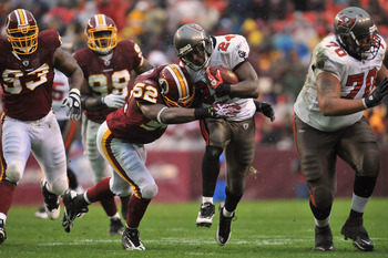 LANDOVER, MD - DECEMBER 12:  Carnell Williams #2 of the Tampa Bay Buccaneers runs the ball while Rocky Mcintosh #52 of the Washington Redskins defends at FedExField on December 12, 2010 in Landover, Maryland. The Buccaneers defeated the Redskins 17-16. (P