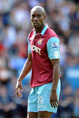 BOLTON, ENGLAND - APRIL 09: Carlton Cole of West Ham United looks on during the Barclays Premier League match between Bolton Wanderers and West Ham United at Reebok Stadium on April 9, 2011 in Bolton, England.  (Photo by Chris Brunskill/Getty Images)