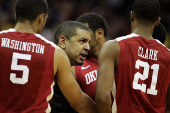 KANSAS CITY, MO - MARCH 09:  Head coach Jeff Capel of the Oklahoma Sooners speaks to his team during their game against the Baylor Bears in the first round of the 2011 Phillips 66 Big 12 Men's Basketball Tournament at Sprint Center on March 9, 2011 in Kan