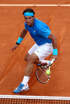 PARIS, FRANCE - MAY 30:  Rafael Nadal of Spain volleys during the men's singles round four match between Rafael Nadal of Spain and Ivan Lubicic of Croatia on day nine of the French Open at Roland Garros on May 30, 2011 in Paris, France.  (Photo by Clive B
