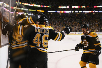 BOSTON, MA - MAY 27:  Nathan Horton #18 of the Boston Bruins celebrates his third period goal with teammates in Game Seven of the Eastern Conference Finals against the Tampa Bay Lightning during the 2011 NHL Stanley Cup Playoffs at TD Garden on May 27, 20