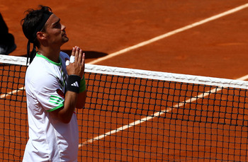 PARIS, FRANCE - MAY 29:  Fabio Fognini of Italy appeals to the crowd as he is booed after winning the men's singles round four match between Fabio Fognini of Italy and Albert Montanes of Spain on day eight of the French Open at Roland Garros on May 29, 20