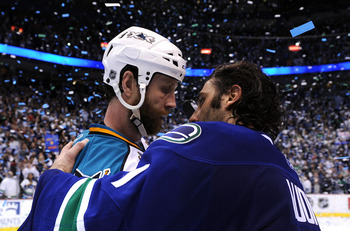VANCOUVER, CANADA - MAY 24:  Goaltender Roberto Luongo #1 of the Vancouver Canucks shakes hands with Joe Thornton #19 of the San Jose Sharks after the Canucks defeated the San Jose Sharks 3-2 in double-overtime in Game Five to win the Western Conference F