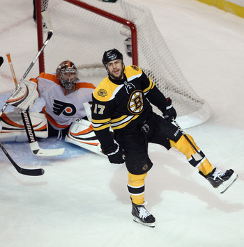BOSTON, MA - MAY 06:  Milan Lucic #17 of the Boston Bruins scores at 12:02 of the first period against Sergei Bobrovsky #35 of the Philadelphia Flyers  in Game Four of the Eastern Conference Semifinals during the 2011 NHL Stanley Cup Playoffs at TD Garden
