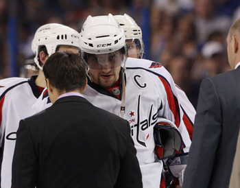 TAMPA, FL - MAY 04: Alex Ovechkin #8 of the Washington Capitals lines up to shake hands with the Tampa Bay Lightning following defeat in Game Four of the Eastern Conference Semifinals during the 2011 NHL Stanley Cup Playoffs at the St Pete Times Forum on