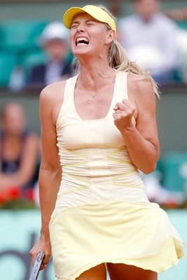 PARIS, FRANCE - MAY 30:  Maria Sharapova of Russia  celebrates winning the first set during the women's singles round four match between Maria Sharapova of Russia and Agnieszka Radwanska of Poland on day nine of the French Open at Roland Garros on May 30,