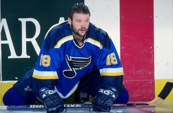 13 Jan 1999: Tony Twist #18 of the St. Louis Blues stretches out on the ice before the game against the Buffalo Sabres at the Marine Midland Arena in Buffalo, New York. The Blues defeated the Sabres 4-2.