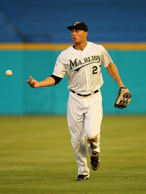 MIAMI GARDENS, FL - MAY 18:  Mike Stanton #27 of the Florida Marlins tosses the ball after making a catch during a game against the Chicago Cubs at Sun Life Stadium on May 18, 2011 in Miami Gardens, Florida.  (Photo by Mike Ehrmann/Getty Images)