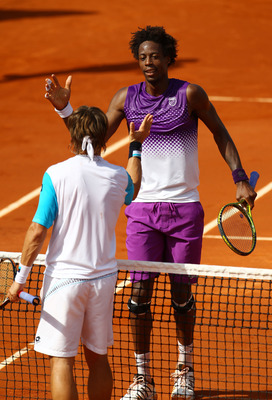 PARIS, FRANCE - MAY 30:  Gael Monfils of France shakes hands with David Ferrer of Spain following his victory during the men's singles round four match between David Ferrer of Spain and Gael Monfils of France on day nine of the French Open at Roland Garro