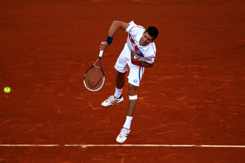 PARIS, FRANCE - MAY 27:  Novak Djokovic of Serbia serves during the men's singles round three match between Juan Martin Del Potro of Argentina and Novak Djokovic of Serbia on day six of the French Open at Roland Garros on May 27, 2011 in Paris, France.  (