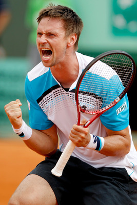 PARIS, FRANCE - MAY 30:  Robin Soderling of Sweden celebrates matchpoint during the men's singles round four match between Gilles Simon of France and Robin Soderling of Sweden on day nine of the French Open at Roland Garros on May 30, 2011 in Paris, Franc