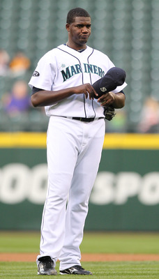 SEATTLE - MAY 04:  Starting pitcher Michael Pineda #36 of the Seattle Mariners pauses after giving up a single against the Texas Rangers at Safeco Field on May 4, 2011 in Seattle, Washington. (Photo by Otto Greule Jr/Getty Images)