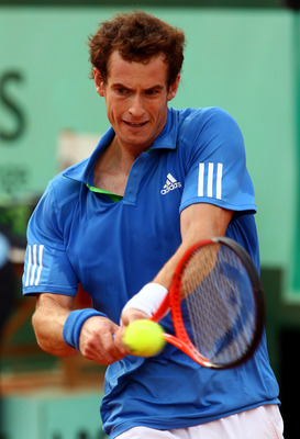 PARIS, FRANCE - MAY 30:  Andy Murray of Great Britain hits a backhand during the men's singles round four match between Andy Murray of Great Britain and Victor Troicki of Serbia on day nine of the French Open at Roland Garros on May 30, 2011 in Paris, Fra