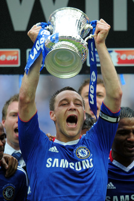 LONDON, ENGLAND - MAY 15:  John Terry of Chelsea holds the Trophy after victory at the end of the FA Cup sponsored by E.ON Final match between Chelsea and Portsmouth at Wembley Stadium on May 15, 2010 in London, England.  (Photo by Shaun Botterill/Getty I