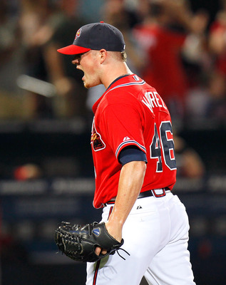 ATLANTA, GA - MAY 29:  Craig Kimbrel #46 of the Atlanta Braves reacts after striking out the last batter in the ninth inning to give the Braves a 2-1 win over the Cincinnati Reds at Turner Field on May 29, 2011 in Atlanta, Georgia.  (Photo by Kevin C. Cox