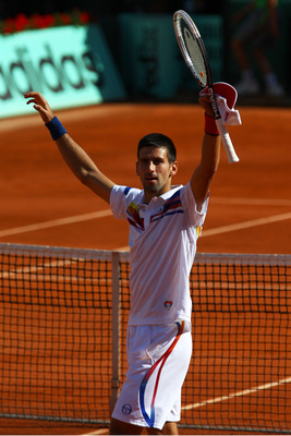 PARIS, FRANCE - MAY 29:  Novak Djokovic of Serbia celebrates matchpoint during the men's singles round four match between Richard Gasquet of France and Novak Djokovic of Serbia on day eight of the French Open at Roland Garros on May 29, 2011 in Paris, Fra
