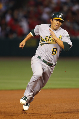 ANAHEIM, CA - MAY 24:  Kurt Suzuki #8 of the Oakland Athletics rounds second base and goes all the way to score from a fly ball hit by David DeJesus #12 in the fourth inning during the game against the Los Angeles Angels of Anaheim at Angel Stadium on May