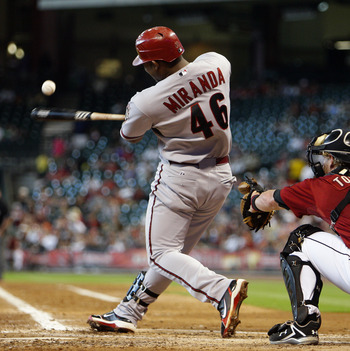 HOUSTON - MAY 29:  Juan Miranda #46 of the Arizona Diamondbacks hits a ball foul during a baseball game against the Houston Astros at Minute Maid Park on May 29, 2011 in Houston, Texas.  (Photo by Bob Levey/Getty Images)