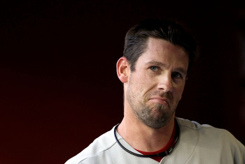 PHOENIX, AZ - APRIL 25:  Starting pitcher Cliff Lee #33 of the Philadelphia Phillies walks in the dugout before the Major League Baseball game against the Arizona Diamondbacks at Chase Field on April 25, 2011 in Phoenix, Arizona. The Diamondbacks defeated