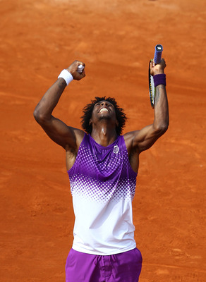 PARIS, FRANCE - MAY 30:  Gael Monfils of France celebrates matchpoint during the men's singles round four match between David Ferrer of Spain and Gael Monfils of France on day nine of the French Open at Roland Garros on May 30, 2011 in Paris, France.  (Ph