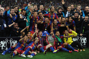 LONDON, ENGLAND - MAY 28:  Barcelona pose for photographs as they celebrate victory in the UEFA Champions League final between FC Barcelona and Manchester United FC at Wembley Stadium on May 28, 2011 in London, England.  (Photo by Jasper Juinen/Getty Imag