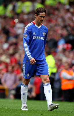 MANCHESTER, ENGLAND - MAY 08:  Fernando Torres of Chelsea walks off at the end of the Barclays Premier League match between Manchester United and Chelsea at Old Trafford on May 8, 2011 in Manchester, England.  (Photo by Alex Livesey/Getty Images)