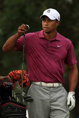 PONTE VEDRA BEACH, FL - MAY 11:  Tiger Woods pulls a club from his bag during a practice round prior to the start of THE PLAYERS Championship held at THE PLAYERS Stadium course at TPC Sawgrass on May 11, 2011 in Ponte Vedra Beach, Florida.  (Photo by Stre