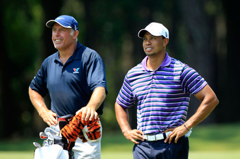 PONTE VEDRA BEACH, FL - MAY 10:  Tiger Woods (R) and caddie Steve Williams look on during a practice round prior to the start of THE PLAYERS Championship held at THE PLAYERS Stadium course at TPC Sawgrass on May 10, 2011 in Ponte Vedra Beach, Florida.  (P