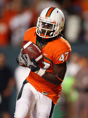 FORT LAUDERDALE, FL - SEPTEMBER 17:  Wide receiver LaRon Byrd #47 of the Miami Hurricanes catches a touchdown pass against the Georgia Tech Yellow Jackets at Land Shark Stadium on September 17, 2009 in Fort Lauderdale, Florida. Miami defeated Georgia Tech