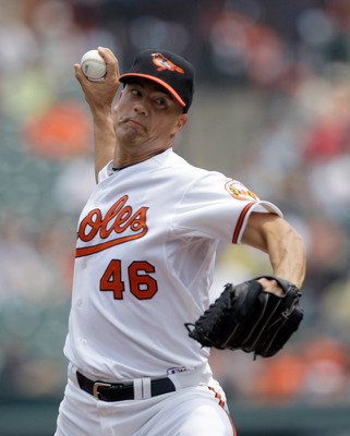 BALTIMORE, MD - MAY 26: Starting pitcher Jeremy Guthrie #46 of the Baltimore Orioles delivers to a Kansas City Royals batter during the first inning at Oriole Park at Camden Yards on May 26, 2011 in Baltimore, Maryland.  (Photo by Rob Carr/Getty Images)