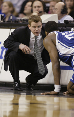WINSTON-SALEM, NC - FEBRUARY 18:  Assistant coach Steve Wojciechowski of the Duke Blue Devils bends down and talks to Shelden Williams #23 during the game against the Wake Forest Demon Deacons on February 18, 2004 at the Lawrence Joel Coliseum in Winston-