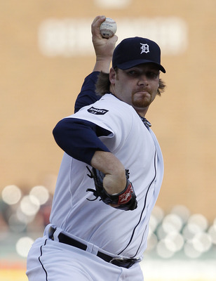 DETROIT - APRIL 26:  Phil Coke #40 of the Detroit Tigers pitches in the second inning during the game against the Seattle Mariners at Comerica Park on April 26, 2011 in Detroit, Michigan. The Mariners defeated the Tigers 7-3.  (Photo by Leon Halip/Getty I