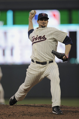 MINNEAPOLIS, MN - MAY 23: Carl Pavano #48 of the Minnesota Twins pitches against the Seattle Mariners during their game on May 23, 2011 at Target Field in Minneapolis, Minnesota. The Rockies won 6-5. (Photo by Hannah Foslien/Getty Images)