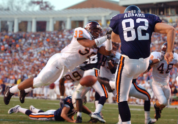 17 Nov 2001:  Wayne Ward #32 of the Virginia Tech Hokies blocks a first half punt by Mike Abrams #82 of the University of Virginia Cavaliers as the Hokies compiled a 31-0 half time lead over the Cavaliers at Scott Stadium on the campus if the University o