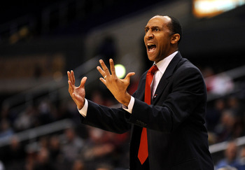 LOS ANGELES, CA - MARCH 11:  Stanford Cardinal Head Coach Johnny Dawkins adjusts his team against the Oregon State Beavers during the Pacific Life Pac-10 Men's Basketball Tournament at the Staples Center on March 11, 2009 in Los Angeles, California.  (Pho