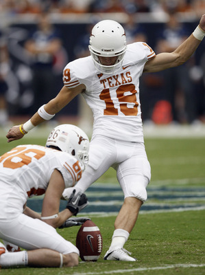 HOUSTON - SEPTEMBER 04:  Kicker Justin Tucker #19 of the Texas Longhorns kicks a field goal out of the hold of Cade McCrary #86 at Reliant Stadium on September 4, 2010 in Houston, Texas.  (Photo by Bob Levey/Getty Images)