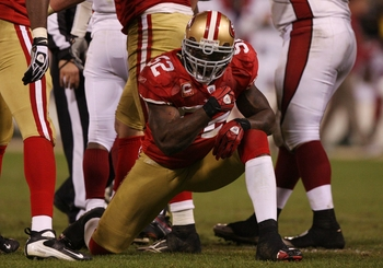 SAN FRANCISCO - DECEMBER 14:  Linebacker Patrick Willis #52 of the San Francisco 49ers reacts after sacking Kurt Warner #13 of the Arizona Cardinals at Candlestick Park on December 14, 2009 in San Francisco, California. (Photo by Jed Jacobsohn/Getty Image