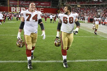 GLENDALE - NOVEMBER 25:  Joe Staley #74 and Adam Snyder #68 of the San Francisco 49ers walk on the field during the NFL game against the Arizona Cardinals at University of Phoenix Stadium on November 25, 2007 in Glendale, Arizona. (Photo by Stephen Dunn/G
