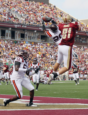 CHESTNUT HILL, MA - SEPTEMBER 25:  Jayron Hosley #20 of the Virginia Tech Hokies intercepts a pass intended for Chris Pantale #81 of the Boston College Eagles as Bruce Taylor #51 of Virginia Tech defends on September 25, 2010 at Alumni Stadium in Chestnut