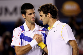 MELBOURNE, AUSTRALIA - JANUARY 27:  Novak Djokovic of Serbia and Roger Federer of Switzerland embrace at the net after their semifinal match during day eleven of the 2011 Australian Open at Melbourne Park on January 27, 2011 in Melbourne, Australia.  (Pho