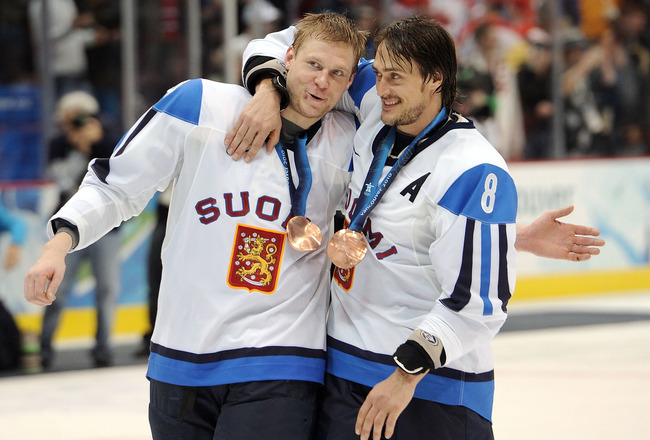VANCOUVER, BC - FEBRUARY 27:  Mikko Koivu #9 and Teemu Selanne #8 of Finland celebrates with his bronze medal after the ice hockey men's bronze medal game between Finland and Slovakia on day 16 of the Vancouver 2010 Winter Olympics at Canada Hockey Place