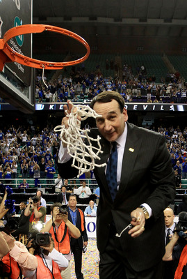 GREENSBORO, NC - MARCH 13:  Head coach Mike Krzyzewski of the Duke Blue Devils cuts down the net after defeating the North Carolina Tar Heels 75-58 in the championship game of the 2011 ACC men's basketball tournament at the Greensboro Coliseum on March 13
