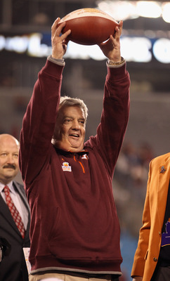 CHARLOTTE, NC - DECEMBER 04:  Head coach Frank Beamer of the Virginia Tech Hokies celebrates winning the ACC Championship 44-33 at Bank of America Stadium on December 4, 2010 in Charlotte, North Carolina.  (Photo by Streeter Lecka/Getty Images)