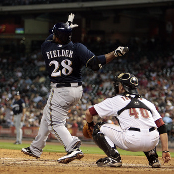 HOUSTON - APRIL 30:  Prince Fielder #28 of the Milwaukee Brewers and catcher J.R. Towels #46 of the Houston Astros watch the ball leave the park in the ninth inning as he hits a home run to right field to tie the game against the Houston Astros at Minute
