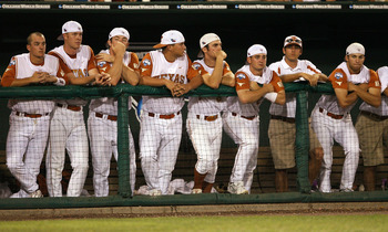 OMAHA, NE - JUNE 24:  The Texas Longhorns watch as the Louisiana State University Tigers celebrate after Game 3 of the 2009 NCAA College World Series at Rosenblatt Stadium on June 24, 2009 in Omaha, Nebraska. The Tigers defeated the Longhorns 11-4 to win