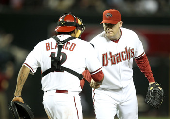 PHOENIX, AZ - MAY 03:  Relief pitcher J.J. Putz #40 of the Arizona Diamondbacks celebrates with catcher Henry Blanco #12 after defeating the Colorado Rockies in the Major League Baseball game at Chase Field on May 3, 2011 in Phoenix, Arizona. The Diamondb