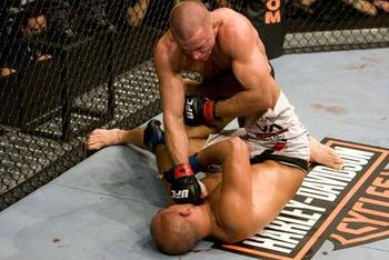 Georges-st-pierre-punches-bj-penn-at-ufc-94_display_image