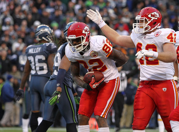 SEATTLE, WA - NOVEMBER 28:  Wide receiver Dwayne Bowe #82 of the Kansas City Chiefs takes a bow after scoring his third touchdown against the Seattle Seahawks at Qwest Field on November 28, 2010 in Seattle, Washington. Mike Cox #42 offers congratulations.