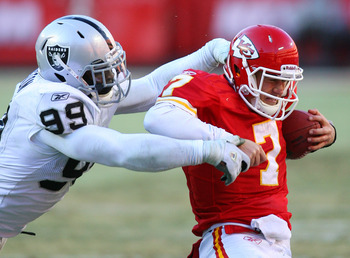 KANSAS CITY, MO - JANUARY 02:  Quarterback Matt Cassel #7 of the Kansas City Chiefs is sacked by defensive end Lamarr Houston #99 of the Oakland Raiders in a game at Arrowhead Stadium on January 2, 2011 in Kansas City, Missouri.  The Raiders won 31-10 (Ph